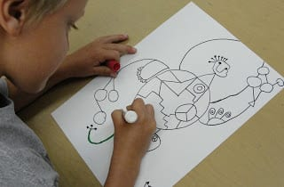 Student drawing Joan Miro figure