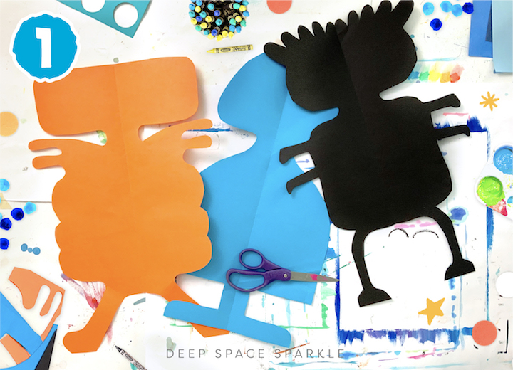 Symmetrical Paper Cut Aliens art project for kids