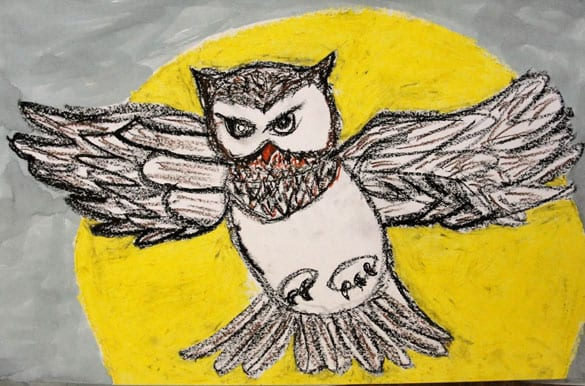 Owl against a yellow moon