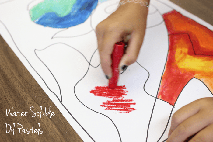 Using water-soluble oil pastels to create an easy abstract painting--without the mess.