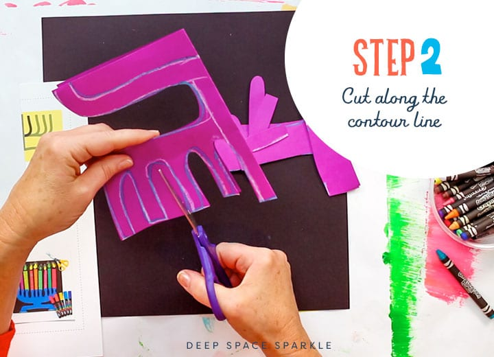making a paper menorah cutting the contour line with scissors