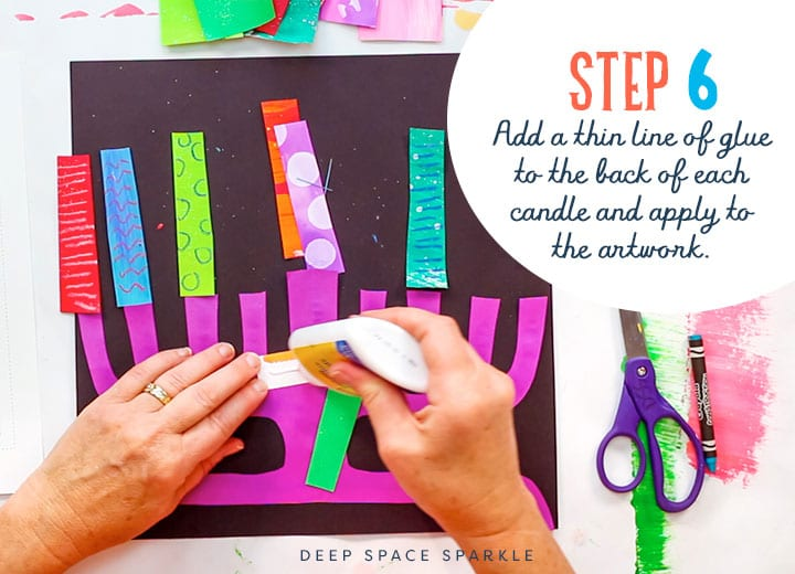 making a paper menorah add glue to candels and apply to artwork