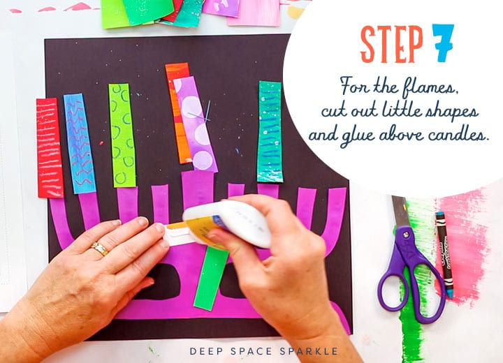 making a paper menorah cut out shapes for flames and glue about candels