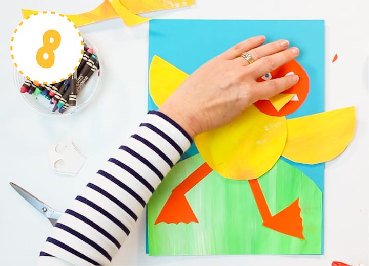 dancing paper duckling art project for kids with step-by-step instructions